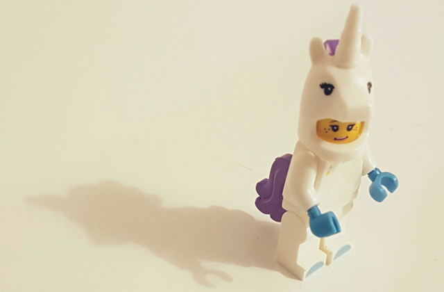 A picture of a lego minifig in a unicorn outfit