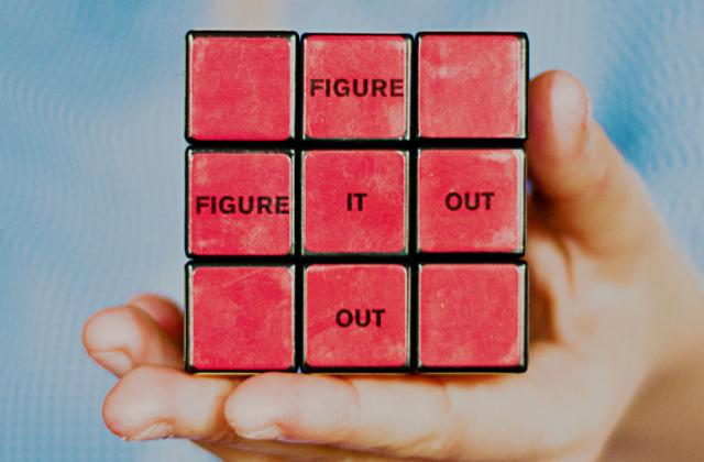 'Figure it out' written on a Rubik's cube